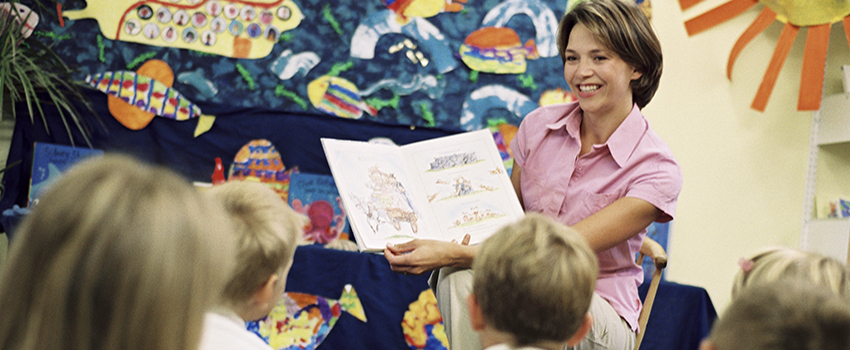 Teacher reading to class.