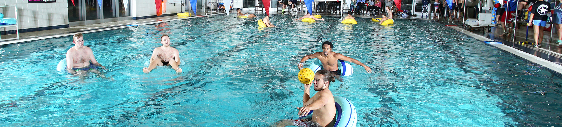 students in rafts in pool