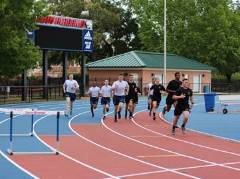 Students running on an outdoor track