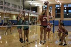 Students playing volleyball in gym
