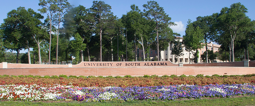 University of South Alabama street sign with flowers.