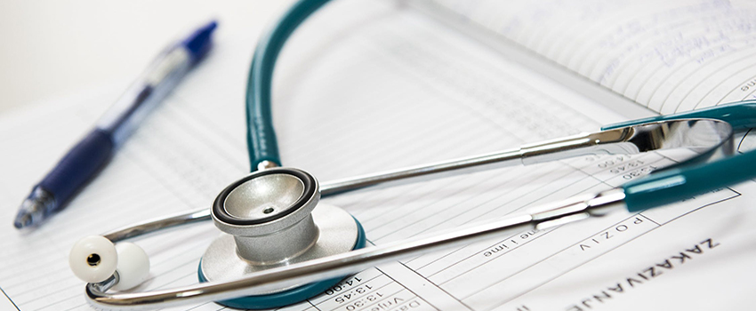Medical Records with stethoscope over it