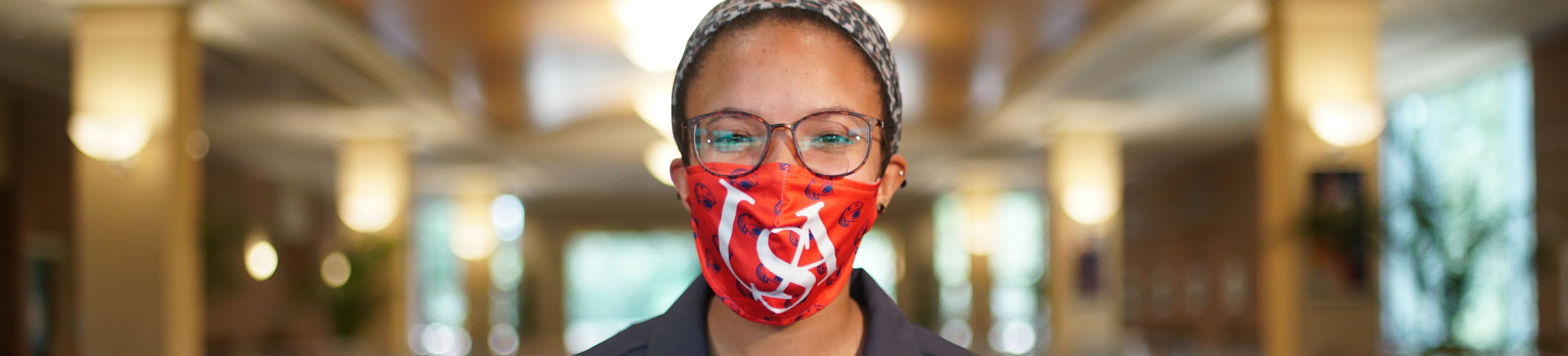 Female student with USA mask on.