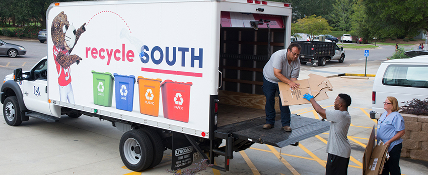 The Recycle South truck being loaded with cardboard